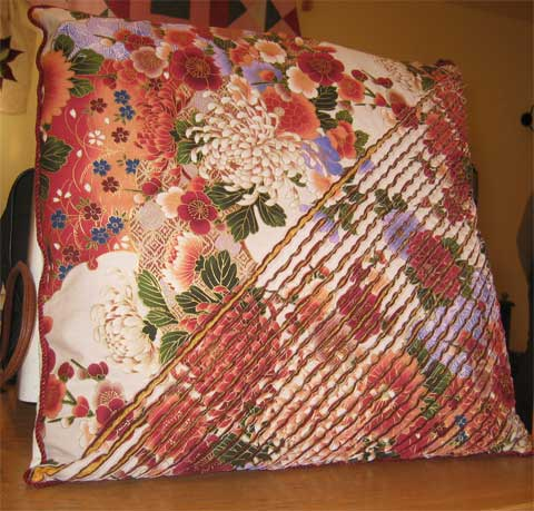 Cushion with a cheille type cover