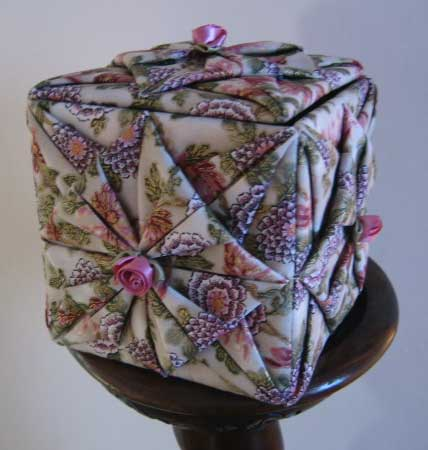 Folded fabric covered Tissue box